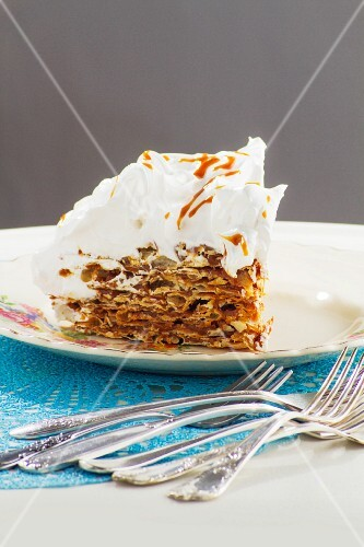 A slice of Torta Rogel (Argentinian pancake cake) with dulche de leche and a meringue topping
