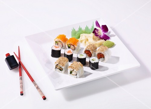A sushi platter of maki and California rolls