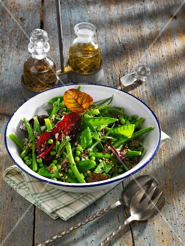 A salad of green beans, peas and mange tout
