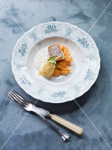 Whitefish fillet with sautéed melon and onion