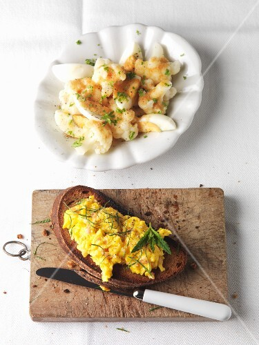 Cauliflower with hard-boiled egg and black bread with scrambled eggs