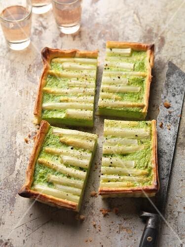 Four portions of asparagus tart