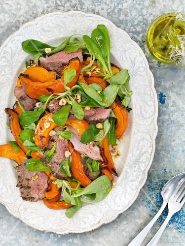 Warm pumpkin salad with lamb, lamb's lettuce and hazelnuts
