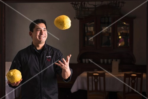 A Japanese chef juggling with lemons