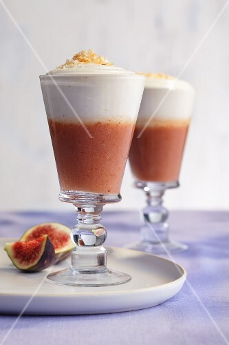 Fig Pina Coladas topped with cream and roasted coconut flakes