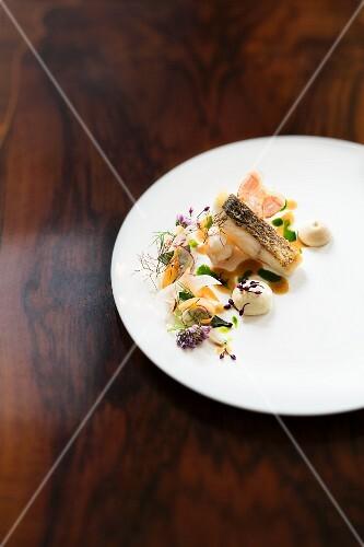Fried seabass with roasted langoustines in the Haerlin restaurant, Hamburg