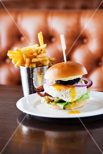 A full English breakfast burger in a restaurant