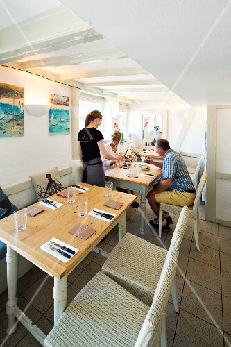 Guests at the Outlaw's Fish Kitchen restaurant (Port Issac, Cornwall) being served