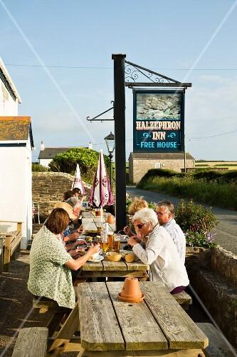 Supper on the terrace of the Halzephron Inn, Cornwall