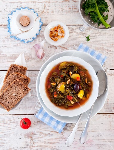 Green kale soup from Portugal with bread and pine nuts