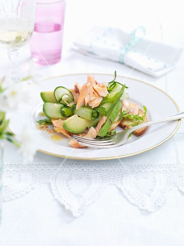 Salmon salad with cucumber and avocado for Easter