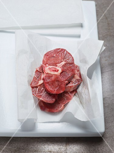 Freshly sliced veal knuckles (Ossobuco) on a piece of paper
