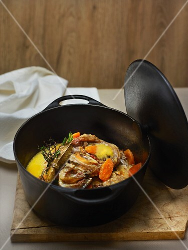 Veal knuckle with cheese, cream, carrots and bouquet garni