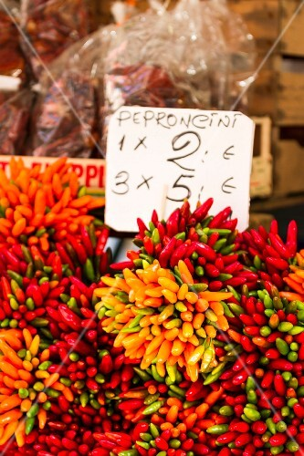 Bunches of fresh chilli peppers at a market