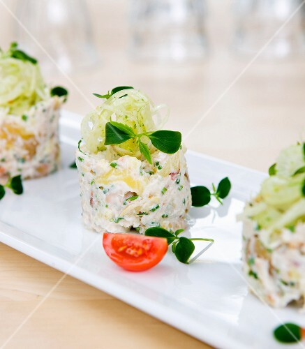 Mashed potatoes with a crab and fennel salad