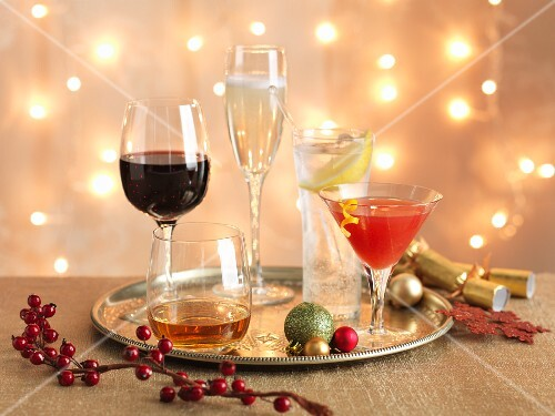 Various Christmas cocktails on a tray