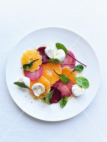 Orange and beetroot salad with red onions and young chard leaves