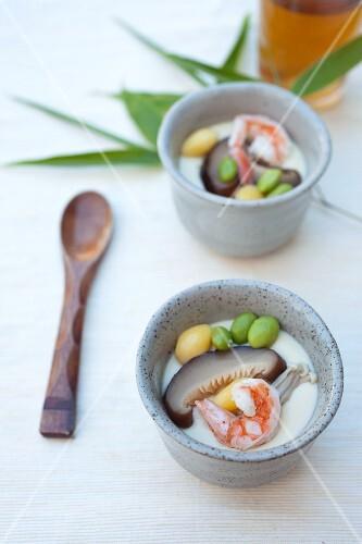 Chawanmushi (Japanese egg soup) with shiitake, enoki, edamame, ginkgo and prawns