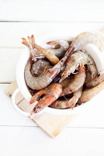 Fresh king prawns in a colander