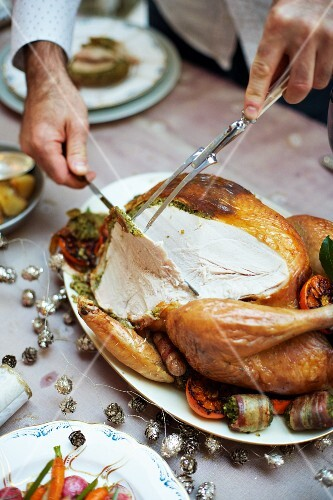 Roast turkey with a herb and pistachio stuffing being carved