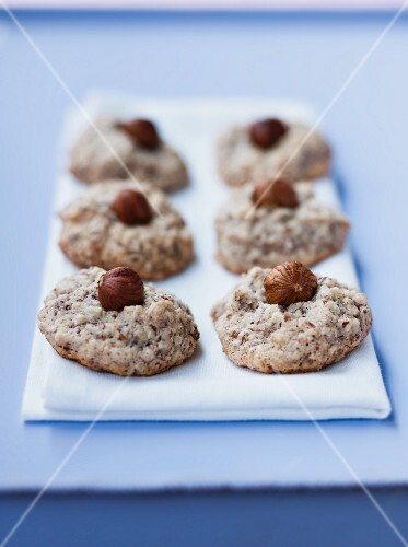Nut macaroons topped with hazelnuts