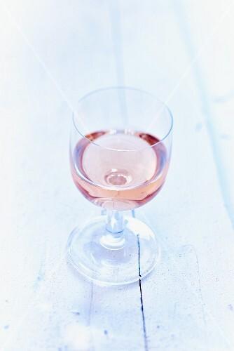 A glass of rosé wine