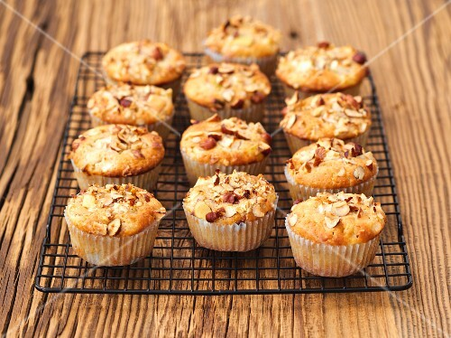 Apple muffins with hazelnuts on a wire rack