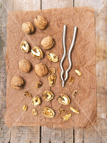 Walnuts, whole and cracked, with a nut cracker