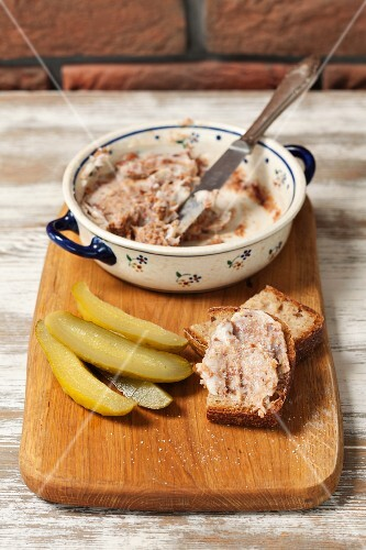 Pork dripping with homemade bread and gherkins