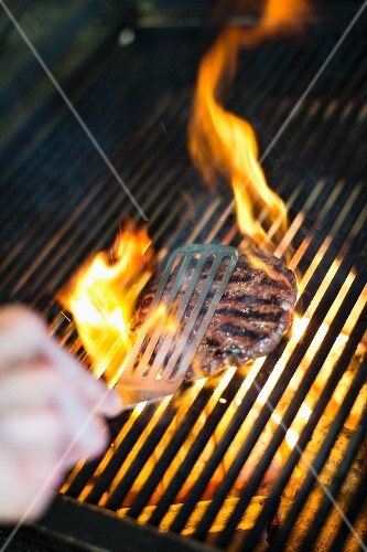 A burger being grilled