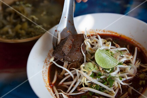 Rice noodle soup with curry and bean sprouts, Thailand
