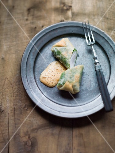 Cabbage wraps with zander and a foamy sauce