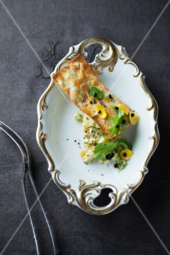 An olive tartlet with marinated goat's cheese