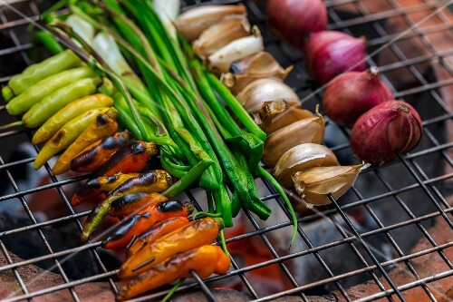 Vegetables being grilled to make a dip (Vientiane, Laos)
