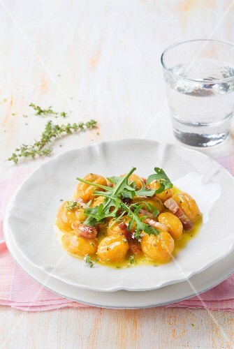 Carrot gnocchi with orange sauce and rocket