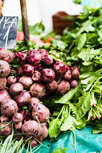 Piles of fresh beetroot on a market stand