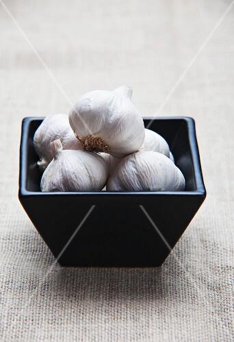 A bowl of garlic bulbs