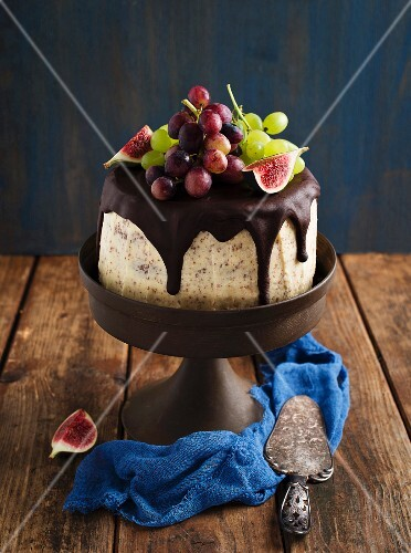Chocolate layer cake with figs and grapes