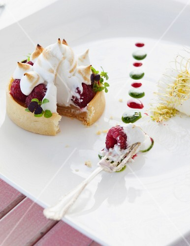 Raspberry tartlet topped with meringue