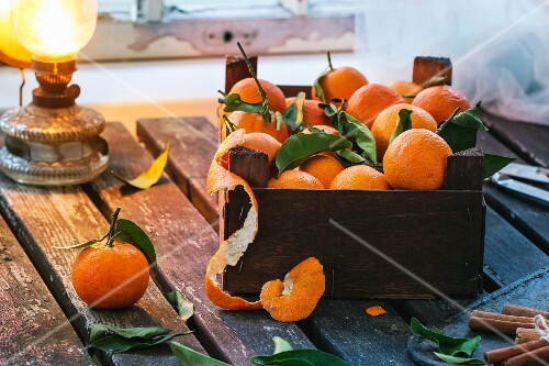 A wooden crate of clementines