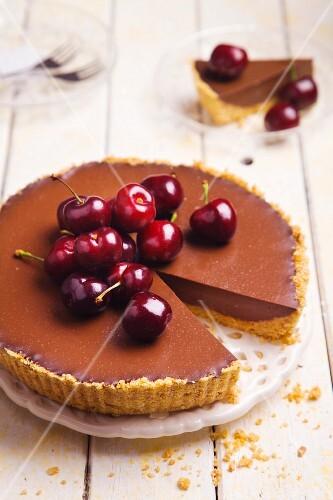 Chocolate and coffee tart with cherries