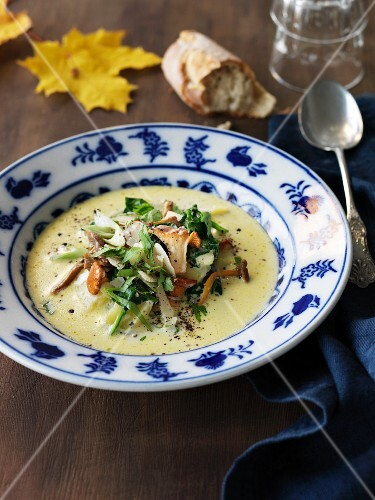 Autumnal chanterelle mushroom soup with herbs and Parmesan cheese