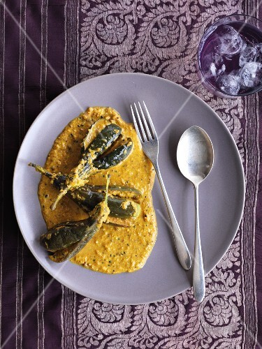 Aubergines with a creamy peanut sauce (India)