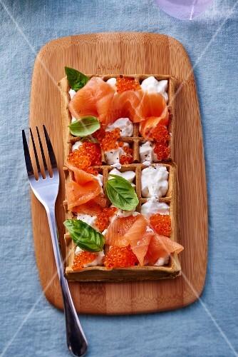 Smoked salmon and chum salmon caviar with cream and basil