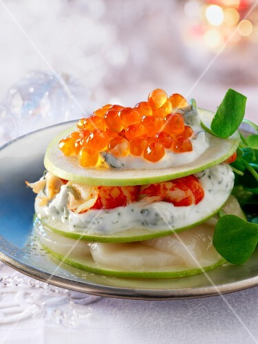 A stack of apple slices, seafood and caviar (Christmas)
