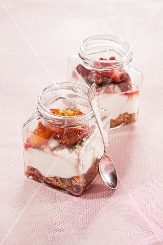 Marinated cheese and nectarines in a jar