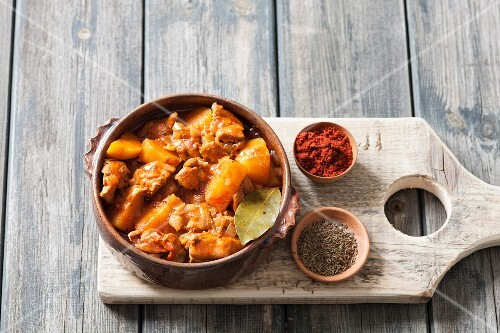 Chicken and potato goulash in a ceramic bowl