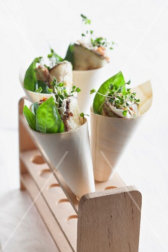 Roasted courgettes filled with ricotta in paper cones