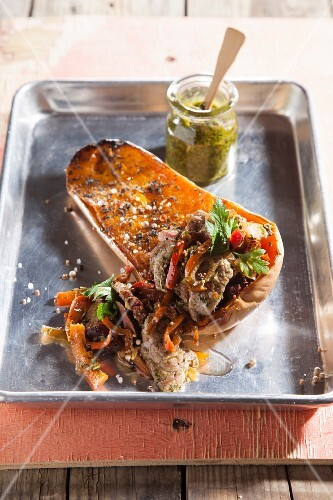 Roasted rump steak with smoked goose and chimichurri on a butternut squash