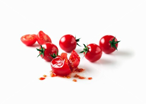 Cherry tomatoes, one squashed